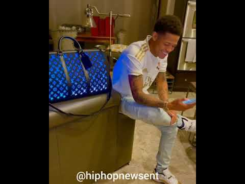 YK Osiris shows off his color changing Louis Vuitton bag